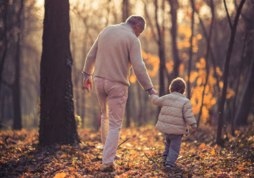 Man walking hand in hand with grandson