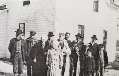 Black and white photo of Stephanie's ancestors outside of the home that they built.