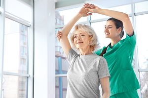 woman lifting arm in therapy